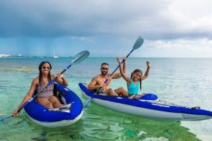 Family out for a kayak on seven mile beach, Grand Cayman